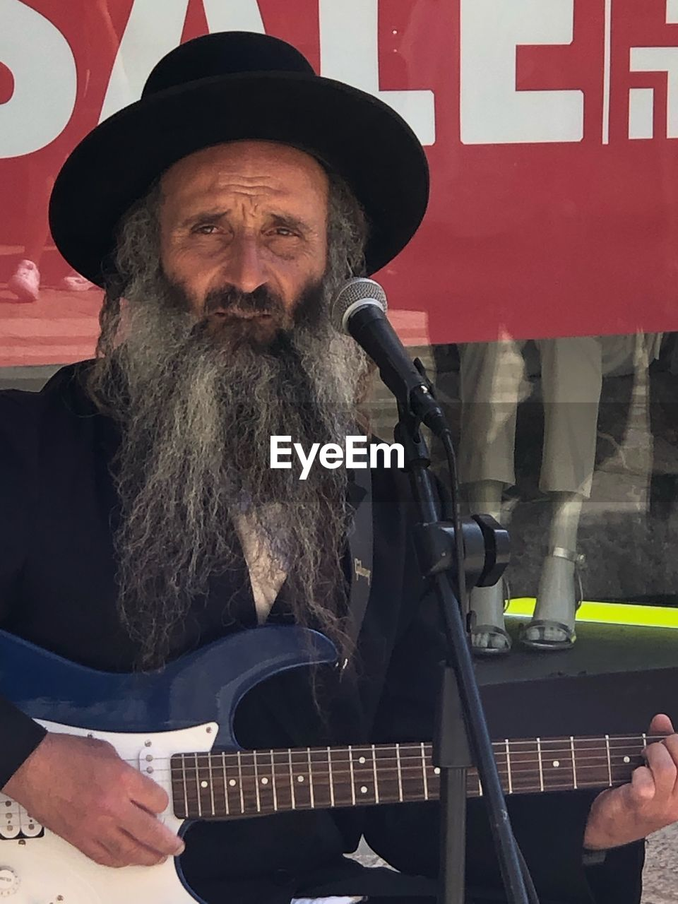 music, men, musical instrument, real people, musician, musical equipment, mature men, guitar, arts culture and entertainment, males, people, mature adult, beard, lifestyles, playing, facial hair, artist, front view, hat, electric guitar, plucking an instrument, entertainment occupation