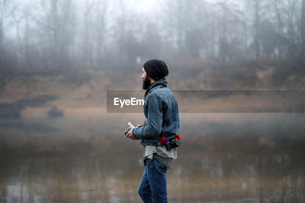 Photographer Holding Camera Outdoors