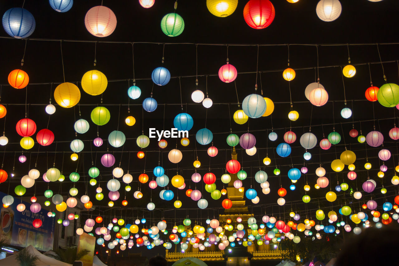 illuminated, multi colored, night, lighting equipment, celebration, decoration, no people, large group of objects, glowing, low angle view, balloon, abundance, light, shape, architecture, geometric shape, hanging, circle, electrical equipment, festival
