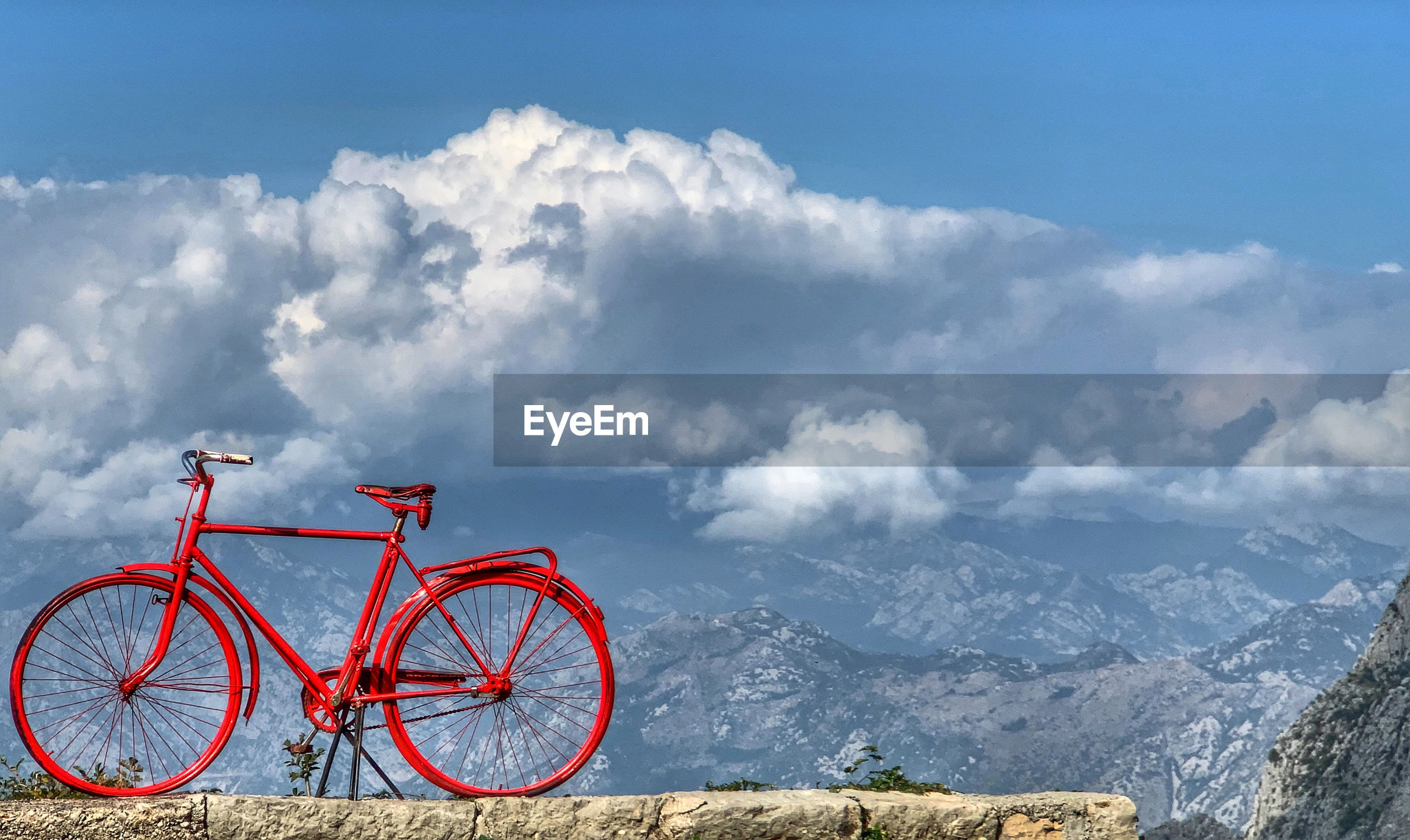 Bicycle against mountains and sky
