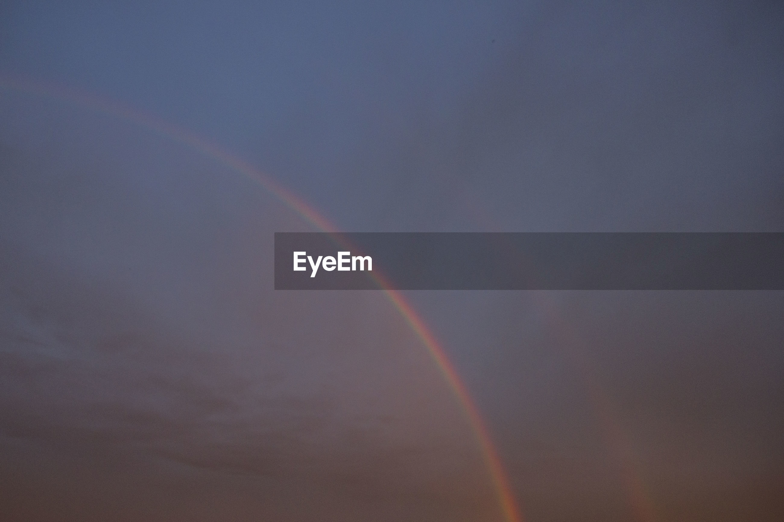 LOW ANGLE VIEW OF RAINBOW OVER SKY