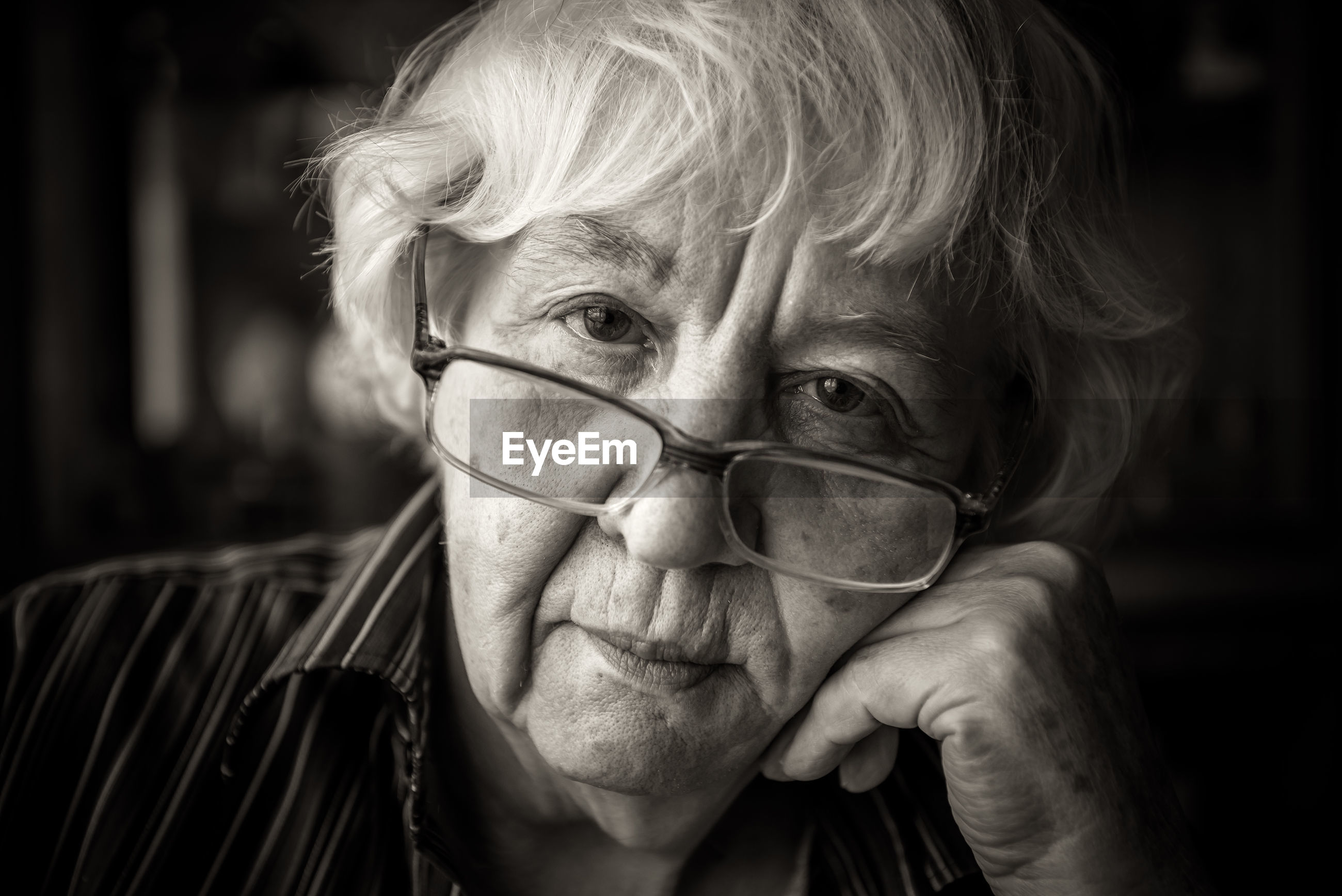 Close-up portrait of senior woman wearing eyeglasses