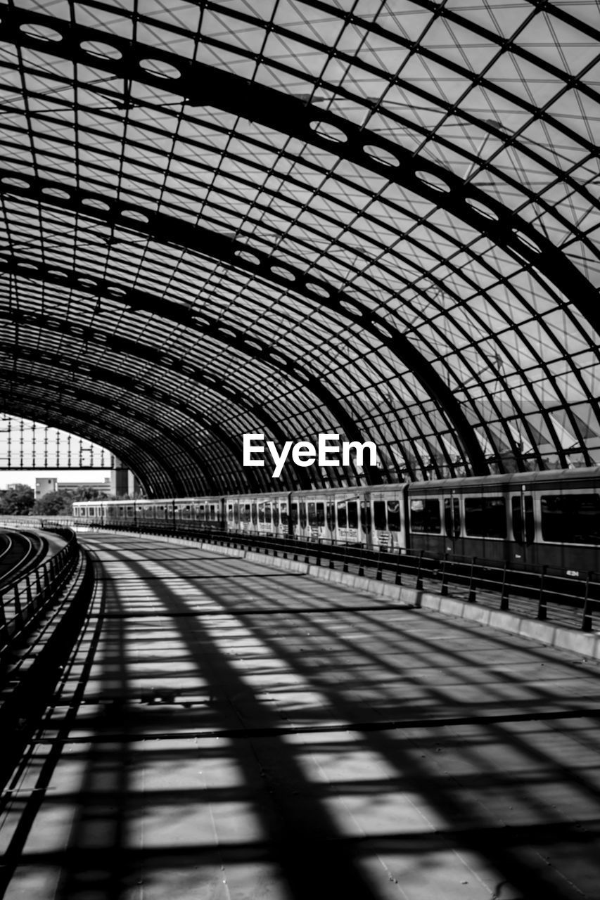 transportation, rail transportation, arch, railroad station, public transportation, indoors, railroad station platform, train - vehicle, railroad track, tunnel, day, travel, built structure, architecture, no people, bridge - man made structure, shadow, subway train