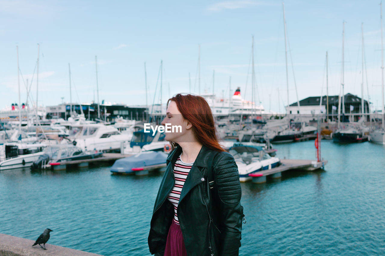 Woman Looking Away While Standing At Harbor