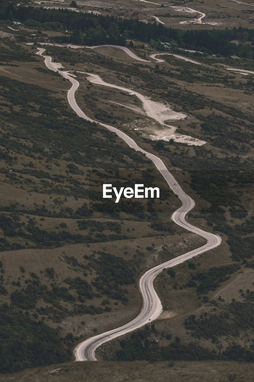 environment, road, aerial view, landscape, land, no people, day, curve, nature, high angle view, transportation, scenics - nature, outdoors, non-urban scene, beauty in nature, tranquility, winding road, pattern, plant, animal