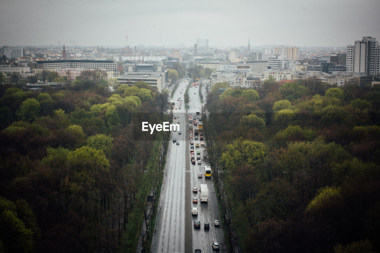 High Angle View Of Vehicles On Road Along Trees