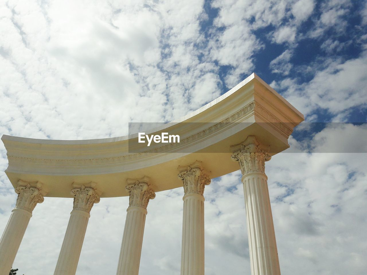 Low angle view of historic columns against sky