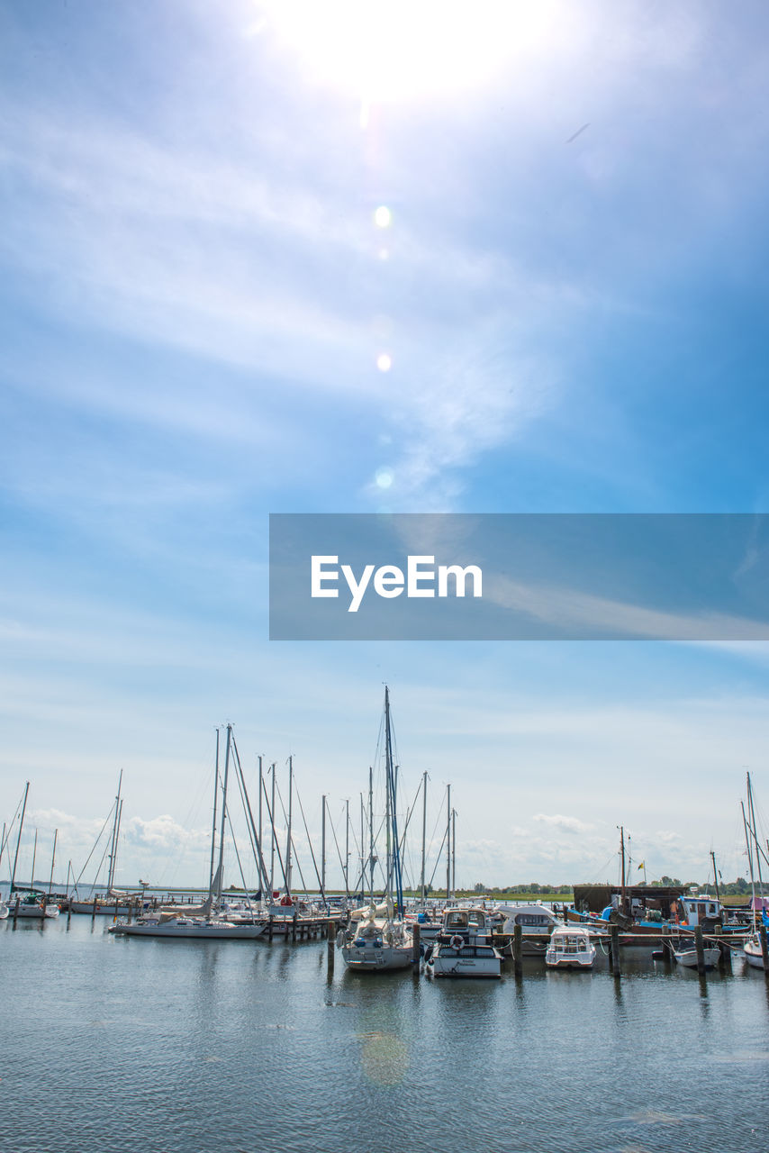nautical vessel, transportation, sky, water, mode of transport, no people, moored, day, outdoors, built structure, harbor, commercial dock, mast, sea, architecture, nature, city