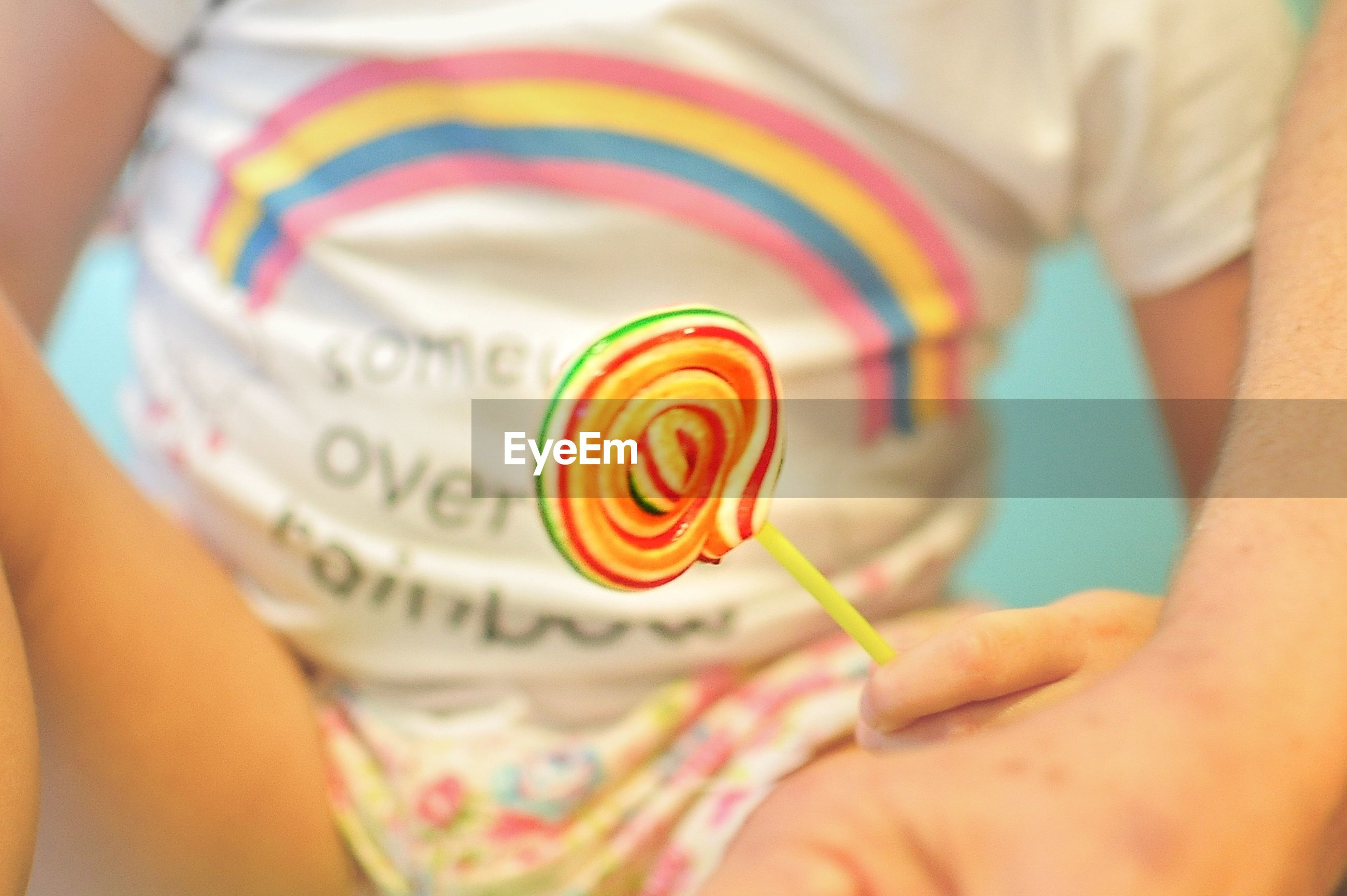 Cropped image of person holding lollipop