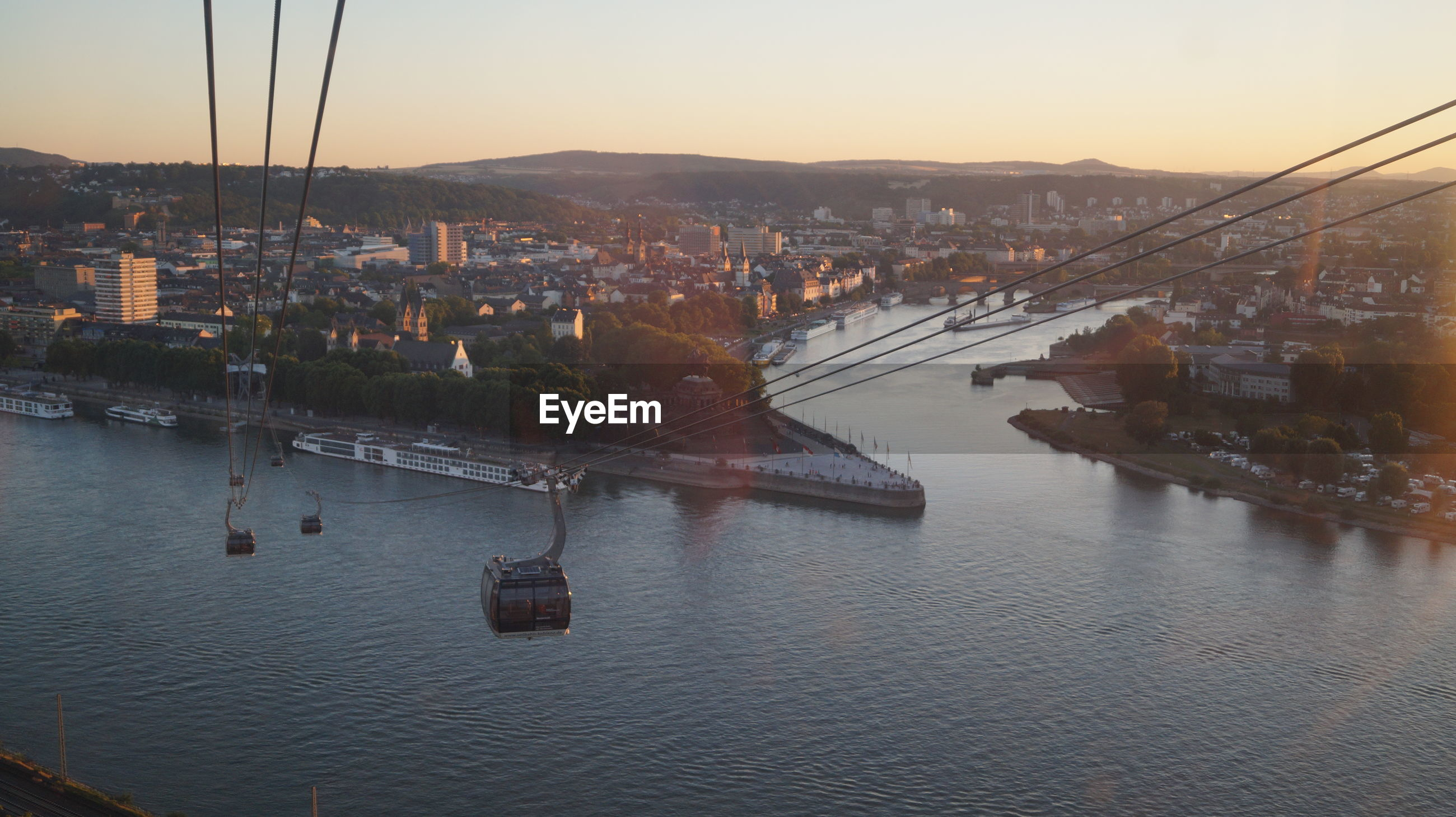 High angle view of overhead cable car over river in city