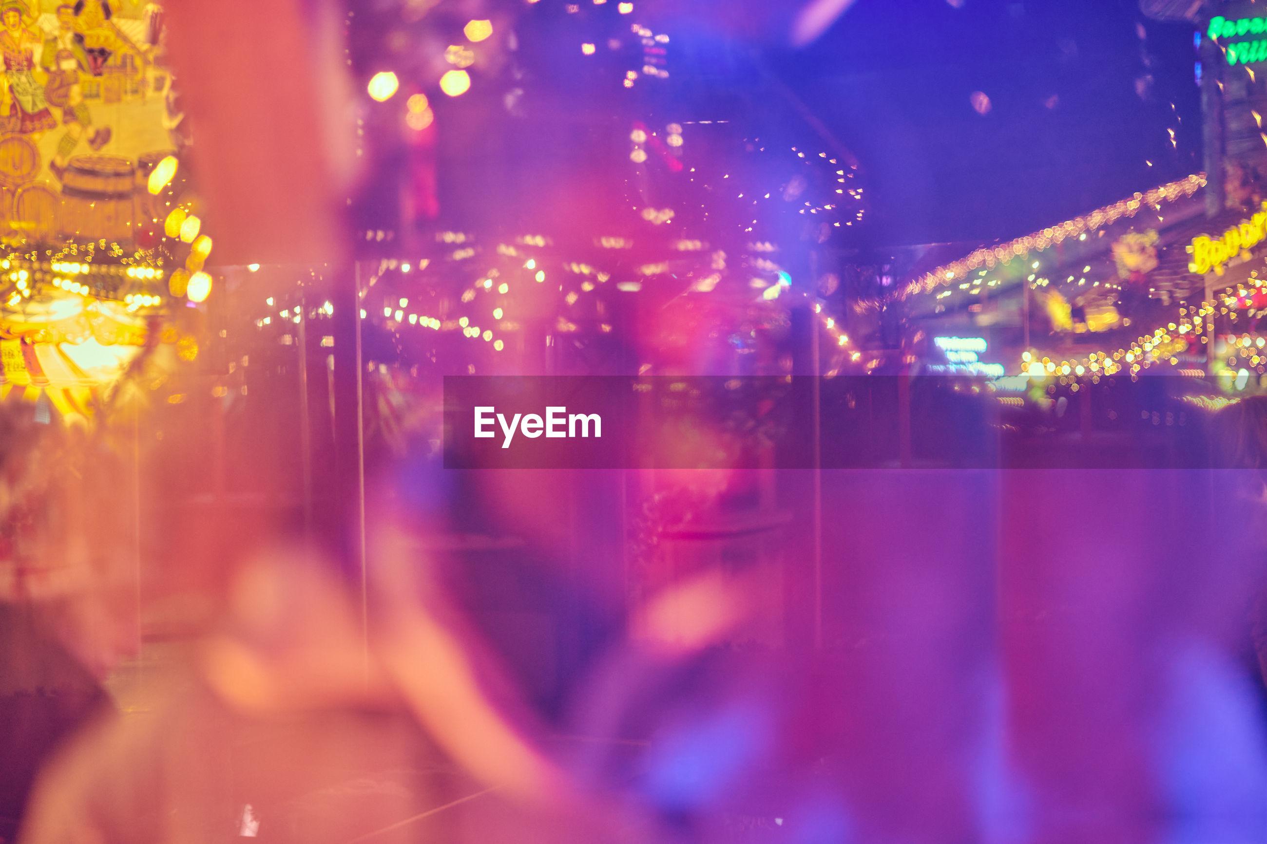 Close-up of illuminated amusement park at night