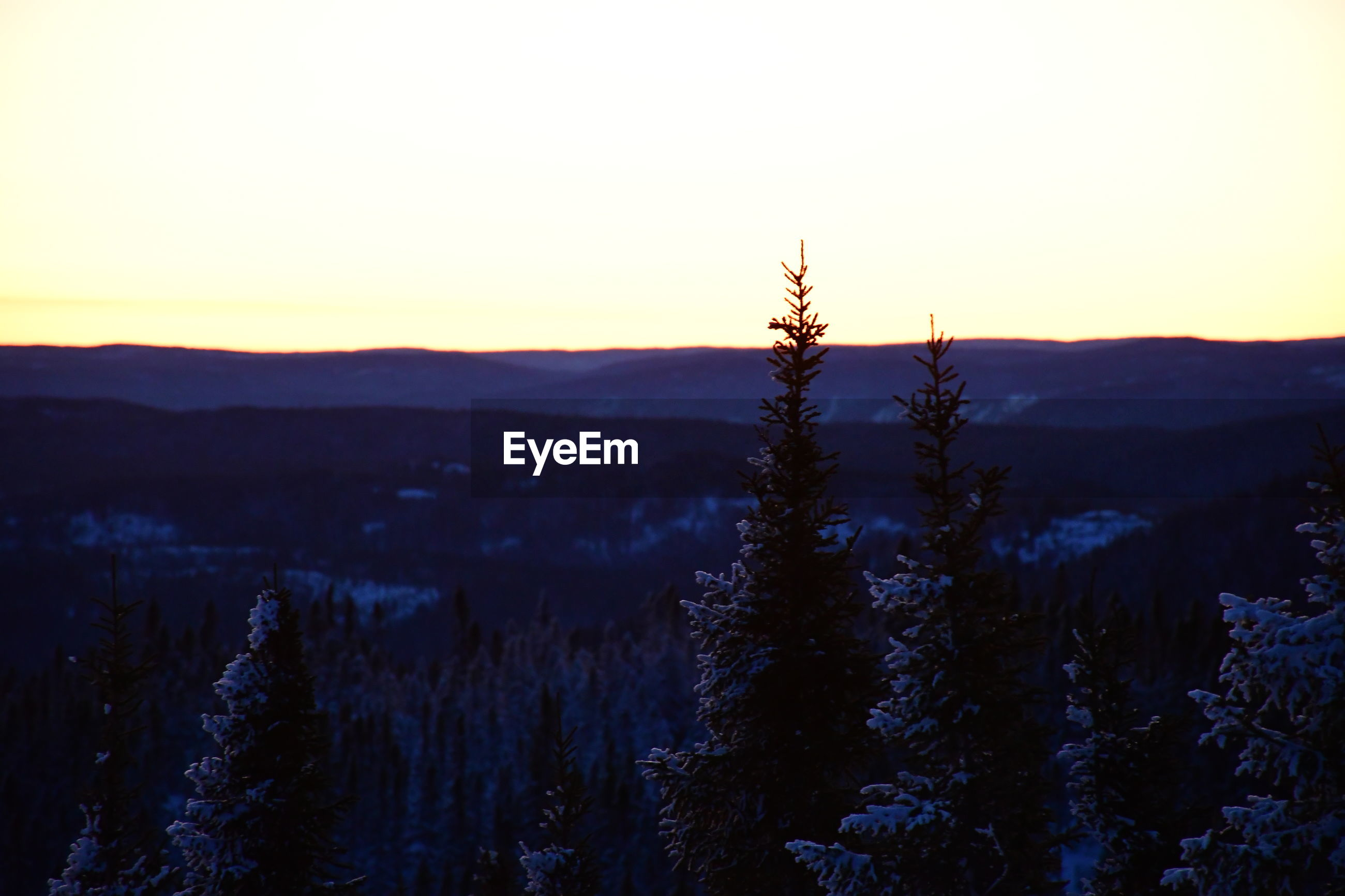 Scenic view of mountain against clear sky during sunset