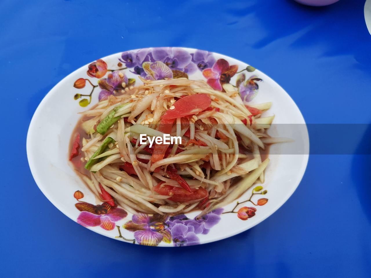 freshness, food and drink, food, plate, indoors, wellbeing, pasta, healthy eating, italian food, ready-to-eat, blue, no people, close-up, table, still life, directly above, vegetable, fruit, high angle view, serving size, spaghetti, blue background, temptation, snack, dinner, crockery, vegetarian food