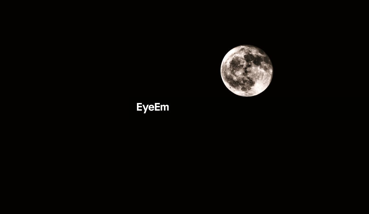 space, astronomy, moon, night, sky, copy space, beauty in nature, full moon, planetary moon, circle, scenics - nature, low angle view, geometric shape, no people, tranquility, moon surface, nature, shape, clear sky, tranquil scene, dark, outdoors, space and astronomy, moonlight, eclipse