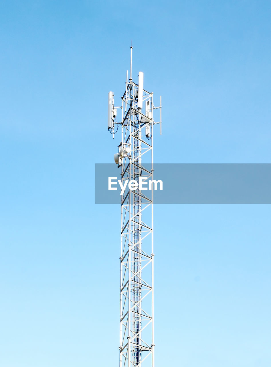 sky, low angle view, clear sky, built structure, communication, blue, technology, architecture, antenna - aerial, tower, copy space, nature, day, no people, tall - high, connection, metal, outdoors, broadcasting, global communications, electrical equipment
