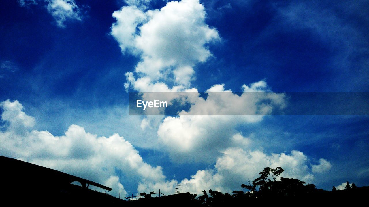 sky, cloud - sky, blue, beauty in nature, nature, low angle view, no people, day, silhouette, outdoors, tranquility, scenics, tree