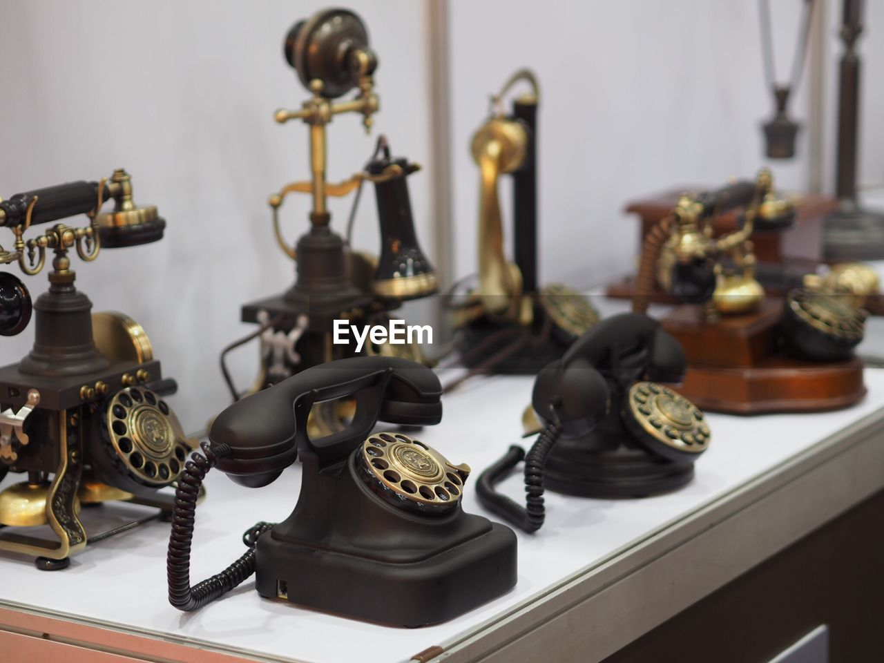 High angle view of vintage telephones on table