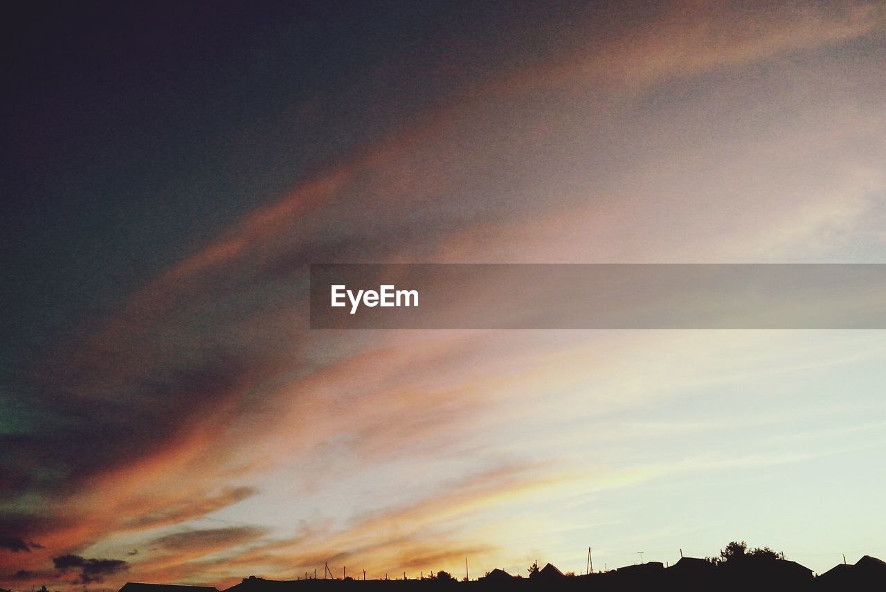 sunset, scenics, beauty in nature, nature, sky, dramatic sky, cloud - sky, tranquil scene, tranquility, orange color, low angle view, silhouette, no people, multi colored, outdoors, sky only, day