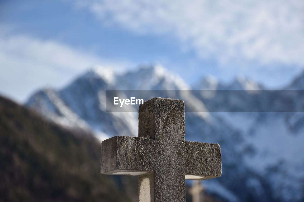 Close-Up Of Cross Shape Against Snowcapped Mountain