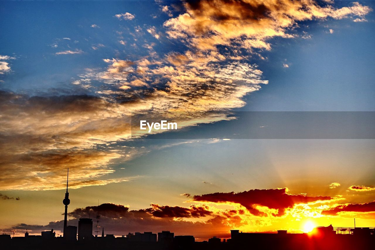 SCENIC VIEW OF DRAMATIC SKY OVER CITY