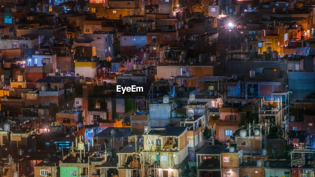 High Angle View Of Illuminated Buildings In Townscape At Night