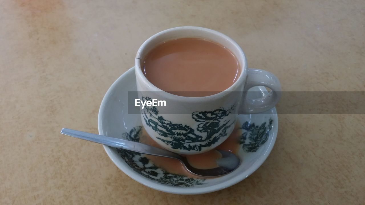 drink, cup, refreshment, mug, food and drink, saucer, crockery, table, tea, spoon, freshness, kitchen utensil, eating utensil, indoors, high angle view, still life, tea - hot drink, food, hot drink, no people, tea cup, floral pattern, non-alcoholic beverage, teaspoon