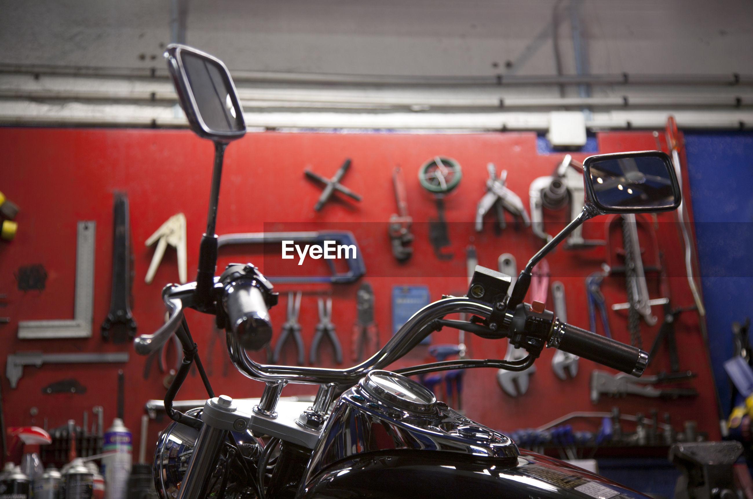 Bikers world, bikers garage, repair tools on a red wall and motorcycle , repairing workshop