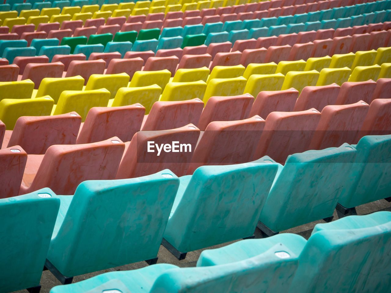 Row Of Multi Colored Bleachers In Stadium