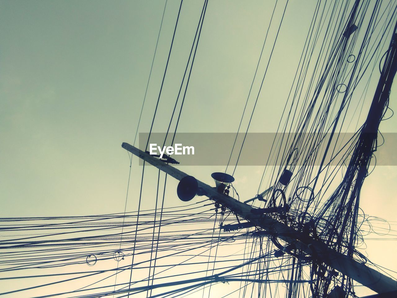 LOW ANGLE VIEW OF CABLES AGAINST SKY