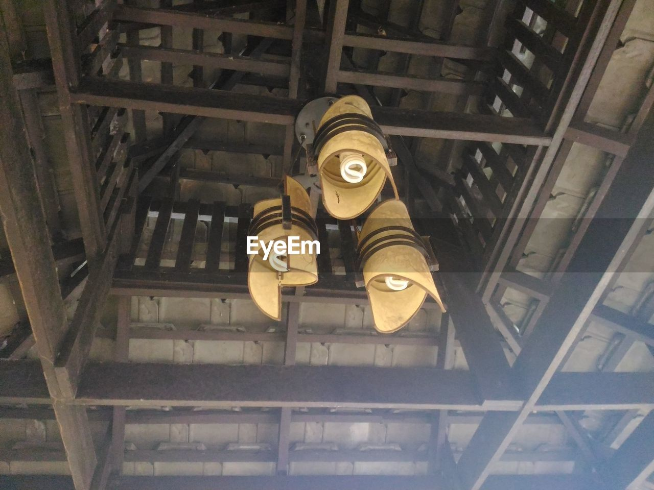 indoors, no people, metal, ceiling, low angle view, industry, technology, machinery, architecture, old, day, factory, built structure, machine part, wood - material, close-up, lighting equipment, still life, industrial equipment