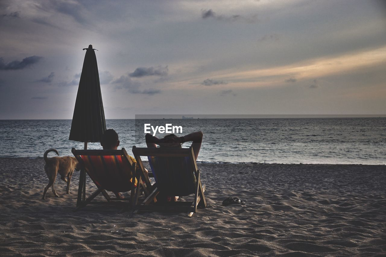 sea, horizon, horizon over water, sky, water, beach, land, chair, seat, beauty in nature, scenics - nature, cloud - sky, nature, sand, sunset, tranquil scene, tranquility, no people, idyllic