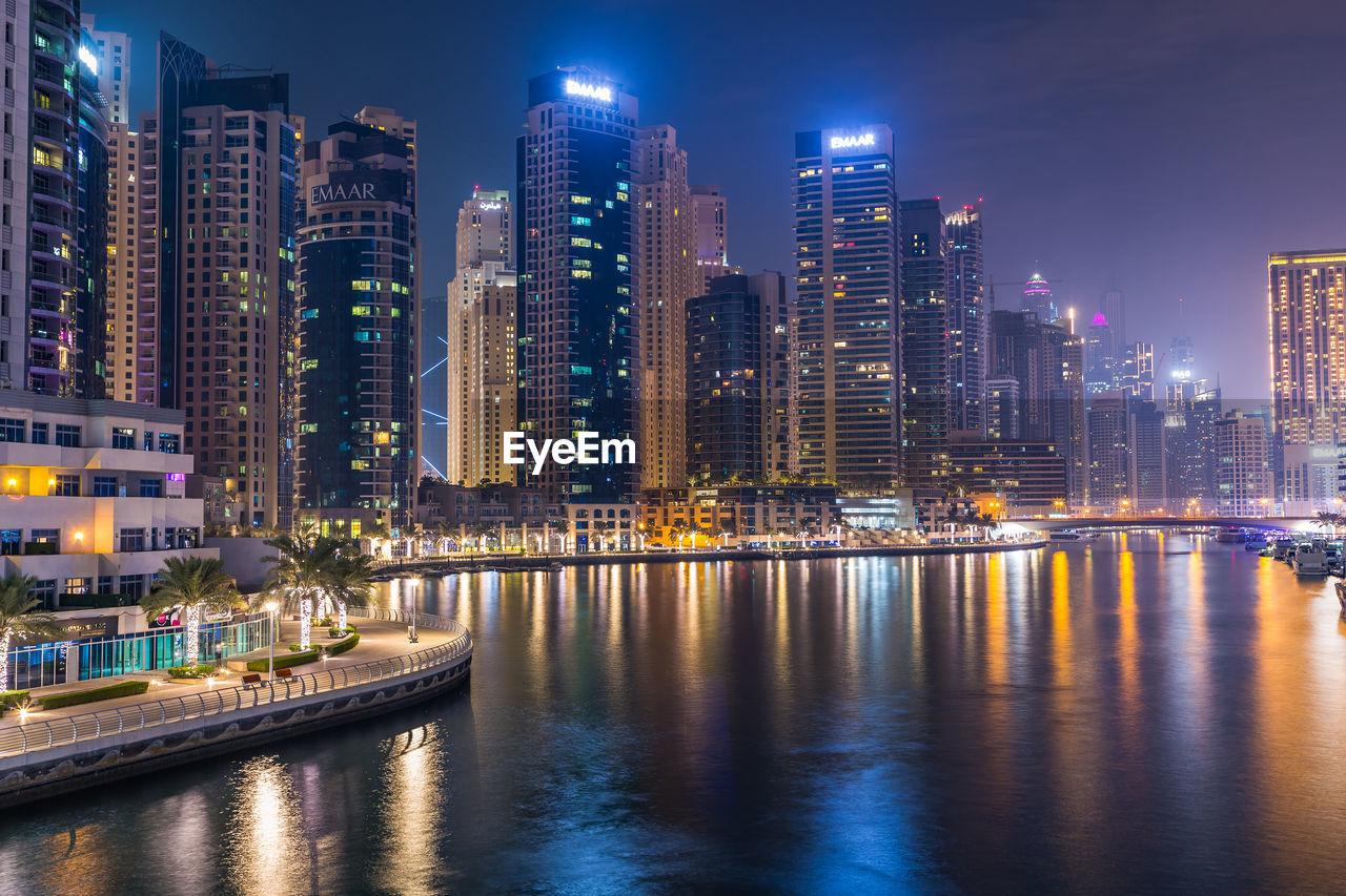 Dubai marina. illuminated modern buildings in city at night