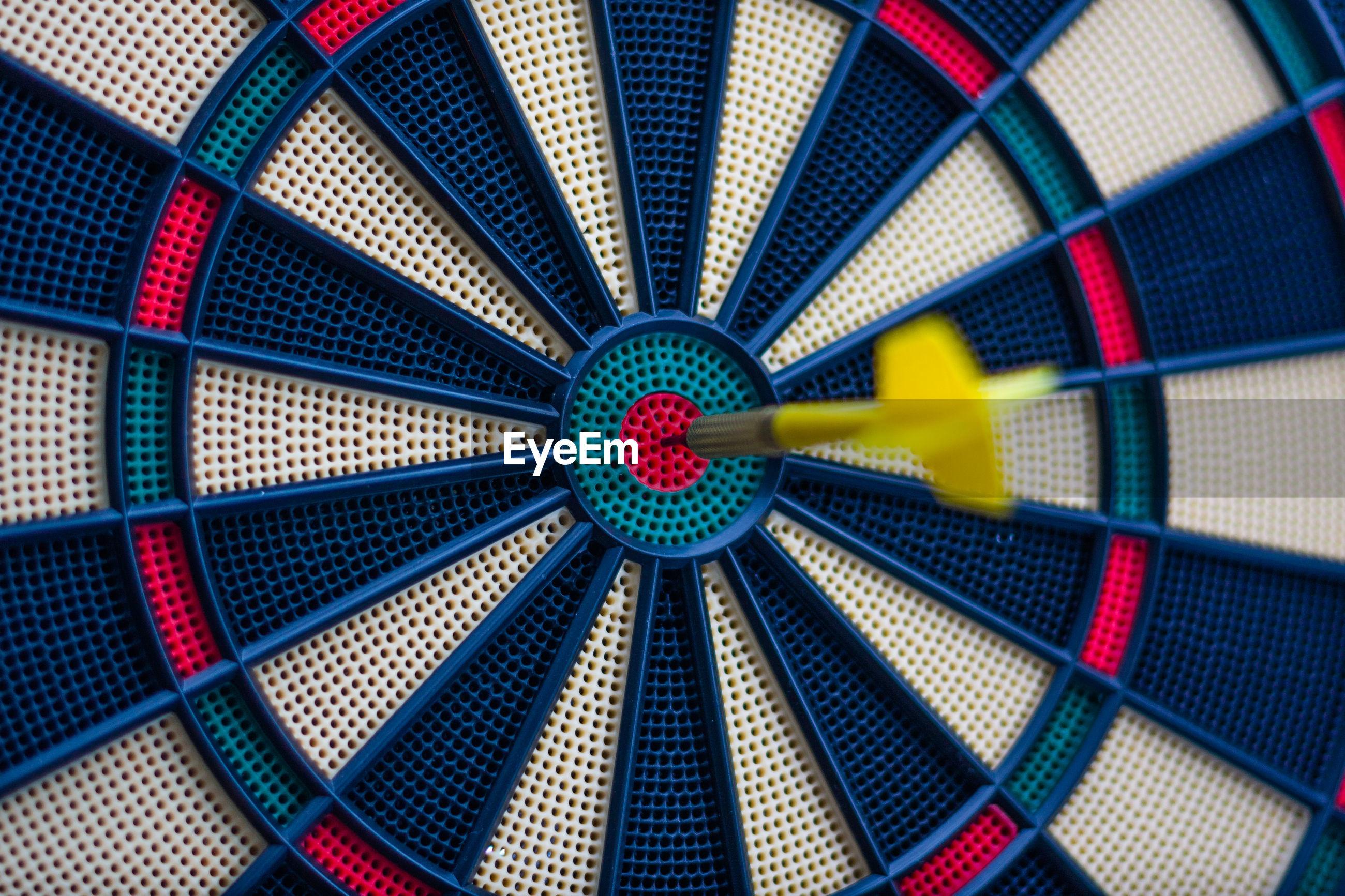 Close-up of dartboard with arrow