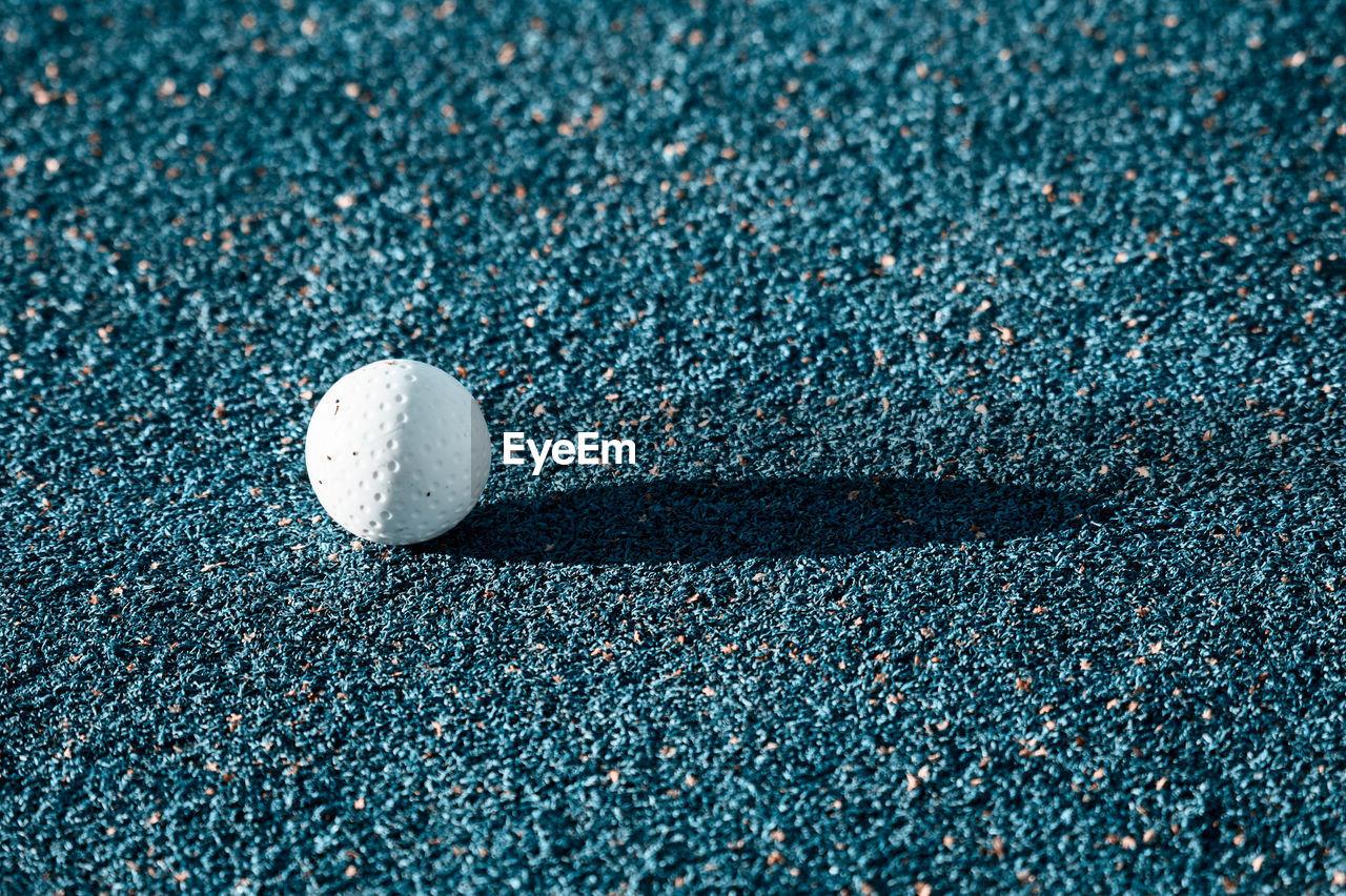 Close-Up Of Golf Ball On Ground