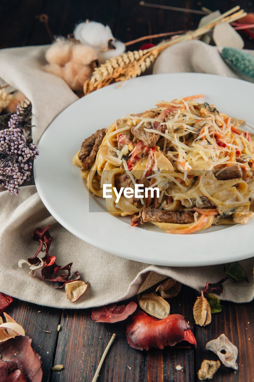 food and drink, food, freshness, table, ready-to-eat, pasta, plate, indoors, italian food, no people, still life, close-up, healthy eating, wellbeing, serving size, spaghetti, high angle view, kitchen utensil, vegetable, spice, garnish, crockery, temptation