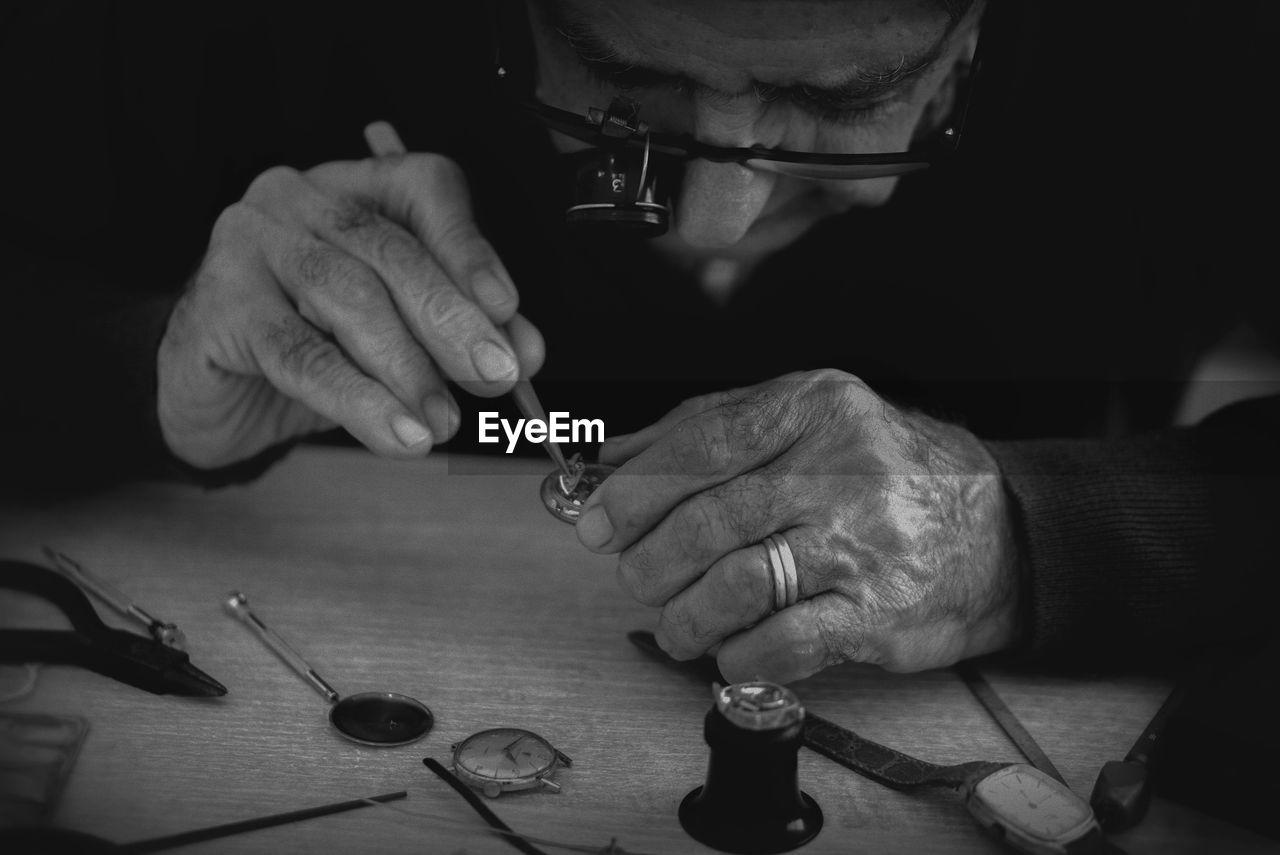 Man fixing pocket watch