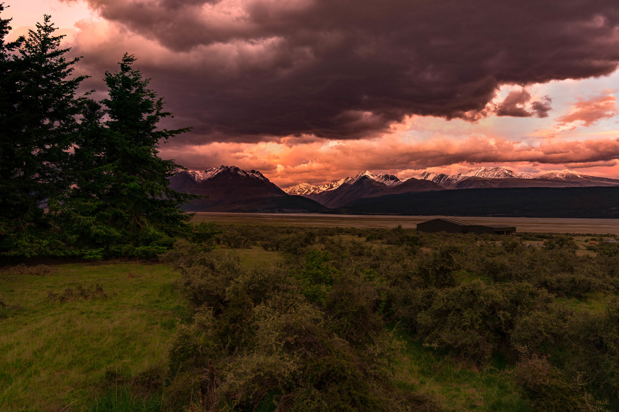 Scenic view of dramatic landscape against romantic sky