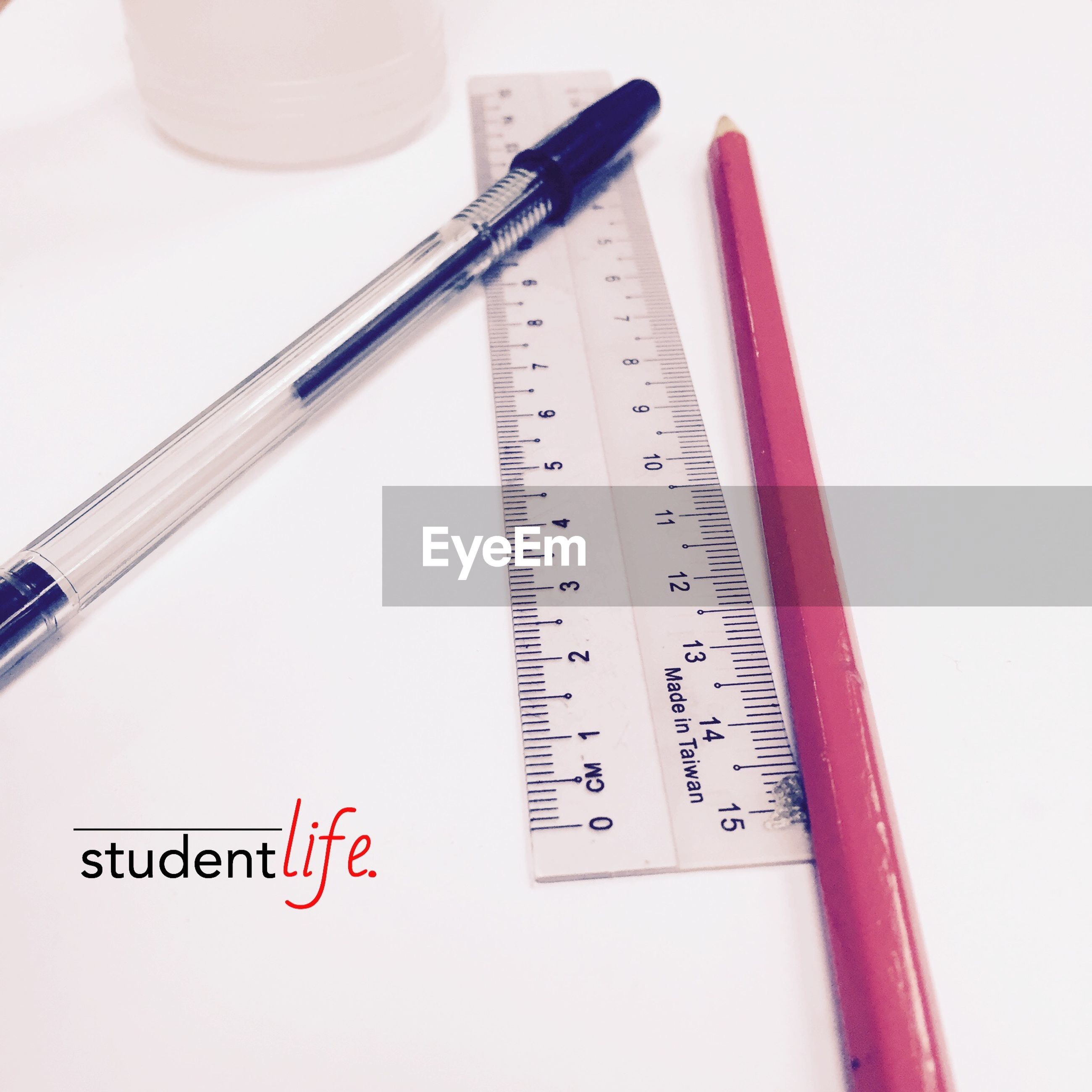 indoors, text, communication, still life, white background, western script, close-up, studio shot, pen, paper, education, no people, pencil, number, high angle view, book, table, equipment, white color, variation