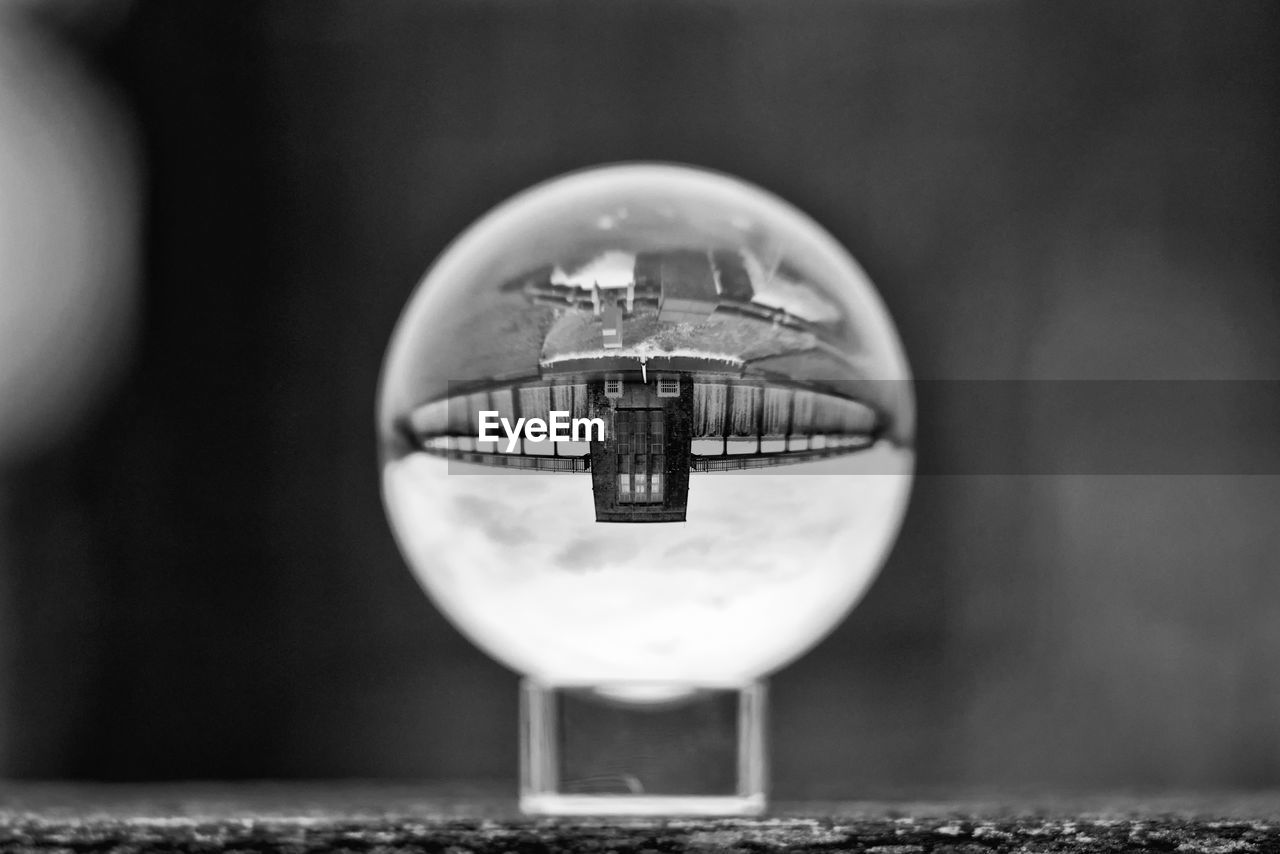 close-up, focus on foreground, no people, reflection, circle, selective focus, geometric shape, shape, built structure, architecture, glass - material, building exterior, lighting equipment, day, metal, outdoors, old, transparent, wall - building feature, electric lamp
