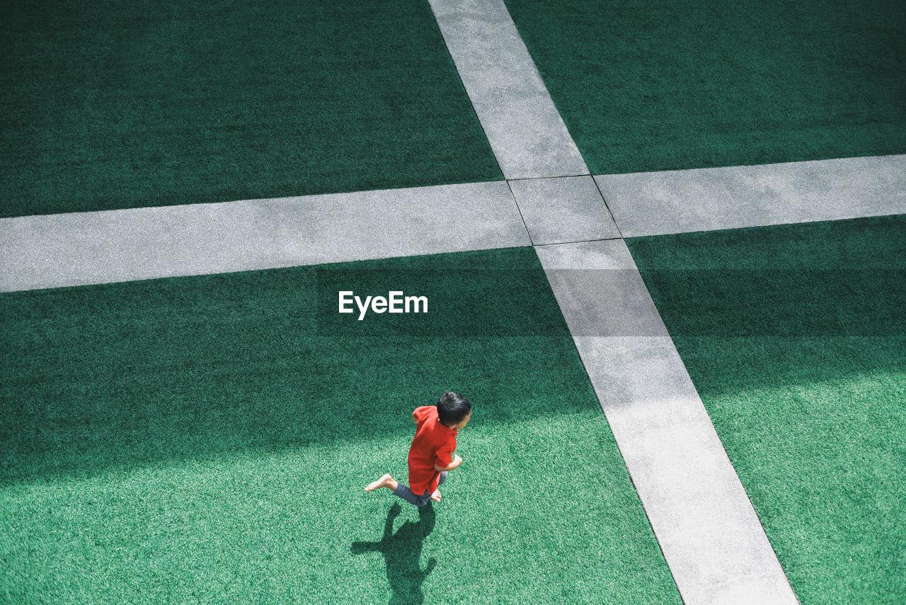 High Angle View Of Boy Running On Stadium