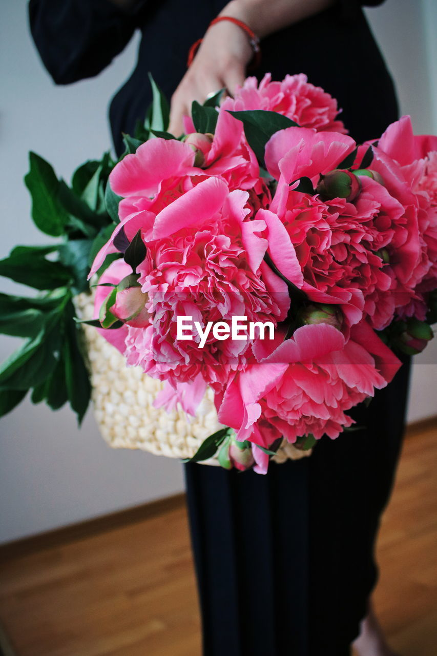 flower, flowering plant, plant, pink color, beauty in nature, freshness, fragility, vulnerability, petal, close-up, nature, flower head, inflorescence, indoors, one person, real people, focus on foreground, flower arrangement, vase, holding, bouquet, bunch of flowers, softness