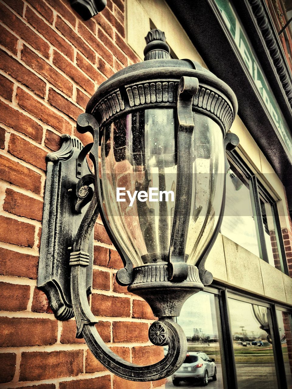 Close-Up Of Antique Street Light On Wall
