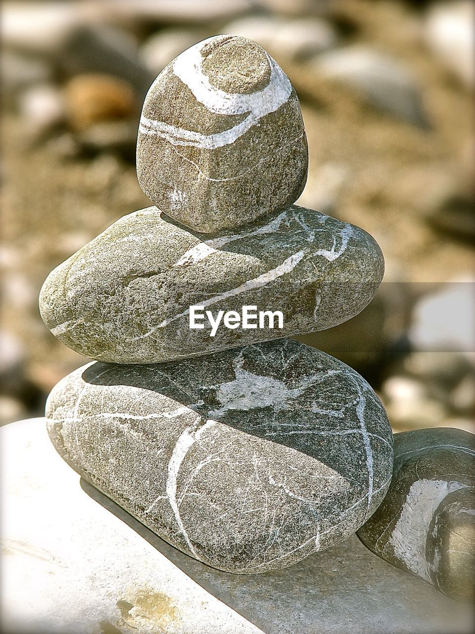 solid, rock, stone - object, no people, stone, focus on foreground, balance, nature, stack, day, close-up, outdoors, rock - object, zen-like, sunlight, pebble, pattern, textured, tranquility, still life