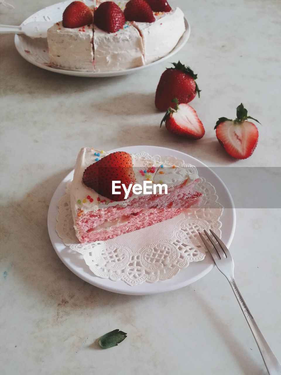 Close-up of strawberry on cake