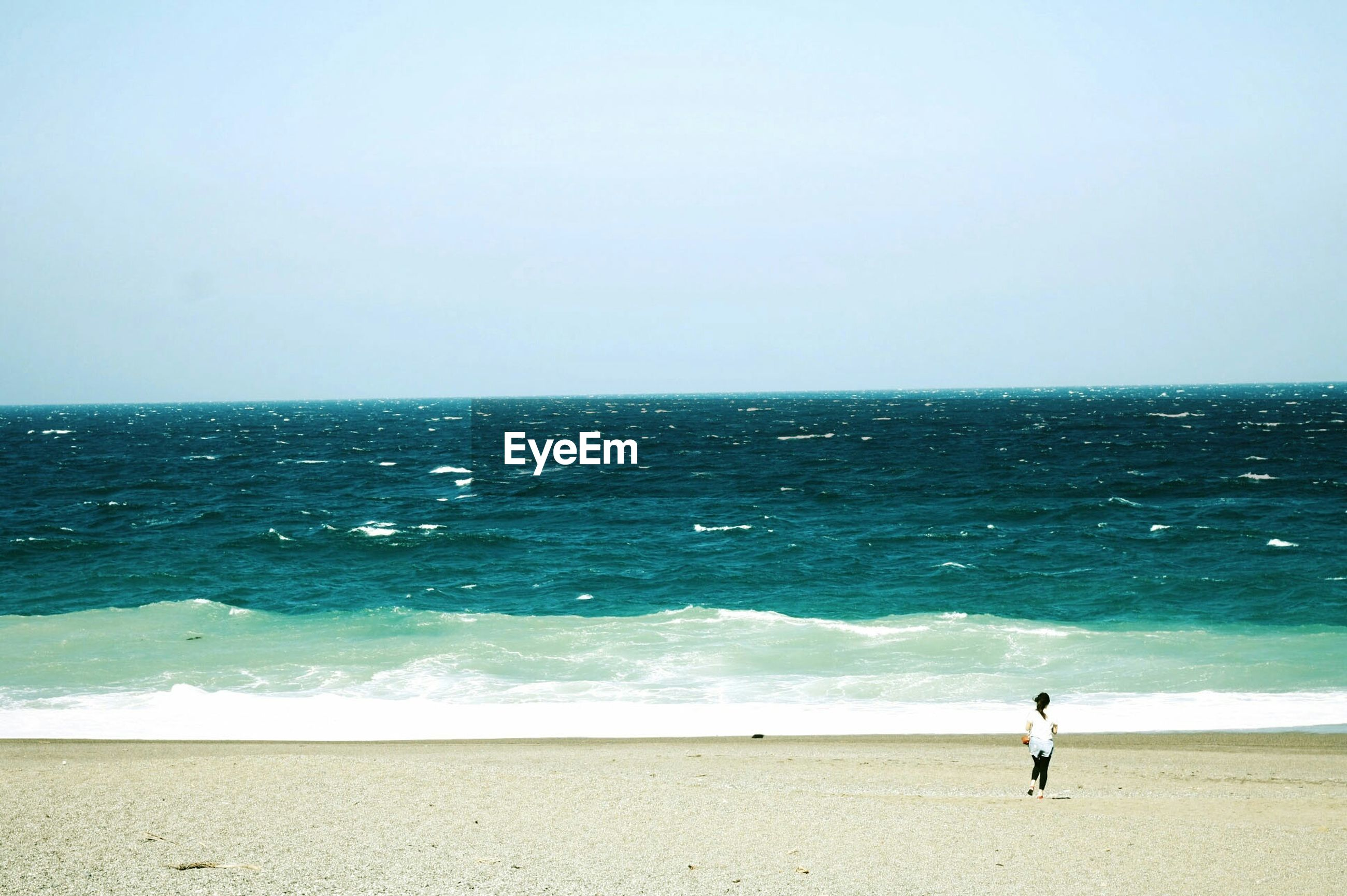 Woman standing on empty beach