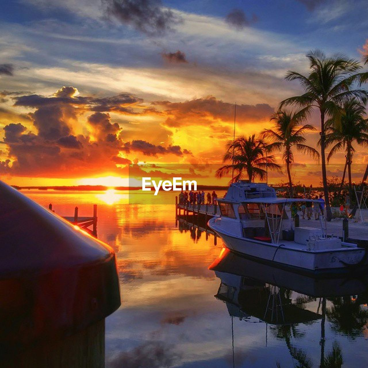 sunset, reflection, nautical vessel, water, sea, sky, cloud - sky, transportation, scenics, nature, tranquility, palm tree, moored, tranquil scene, no people, travel destinations, outdoors, beauty in nature, tree, vacations, beach, day