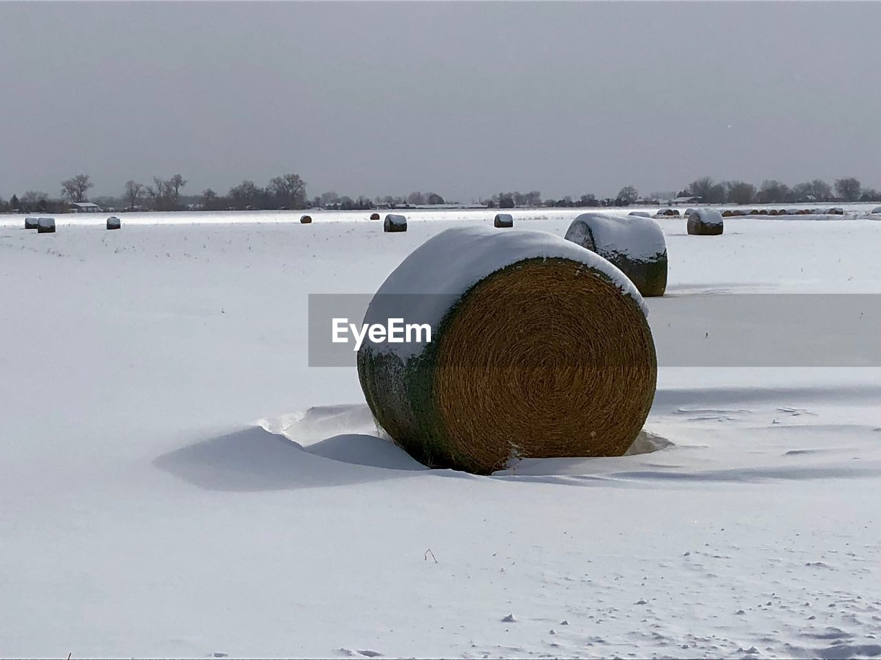 snow, winter, cold temperature, nature, outdoors, field, day, no people, tranquility, beauty in nature, water, landscape, sky, hay bale