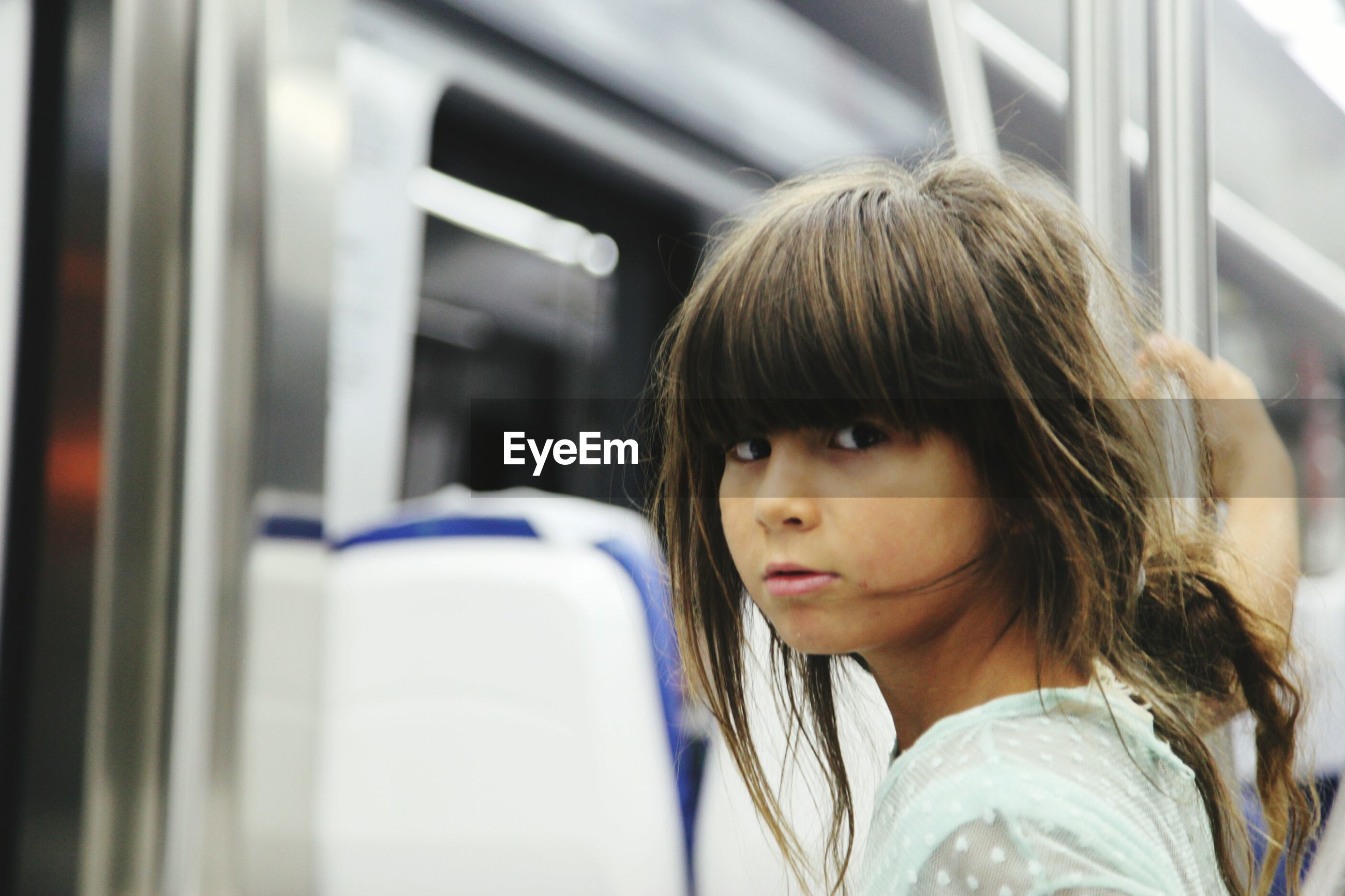 Portrait of girl with brown hair in train