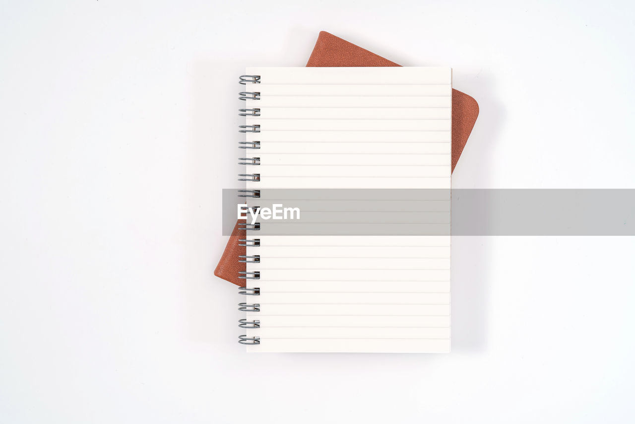 spiral notebook, white background, studio shot, spiral, copy space, paper, no people, still life, note pad, indoors, white color, blank, publication, book, education, high angle view, office supply, pen, close-up, open