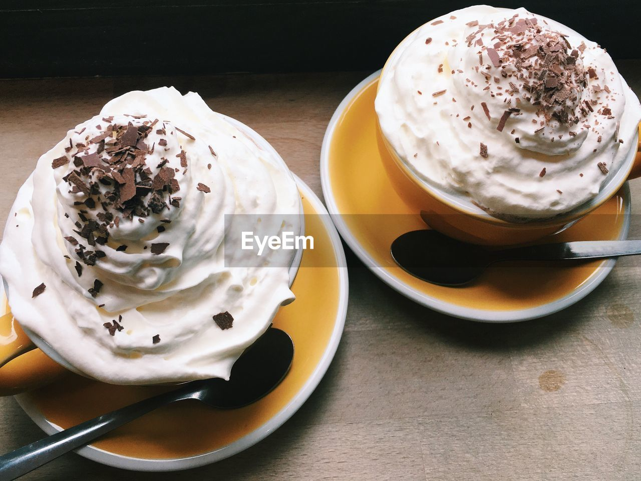 Coffee With Whipped Cream In Cups On Table